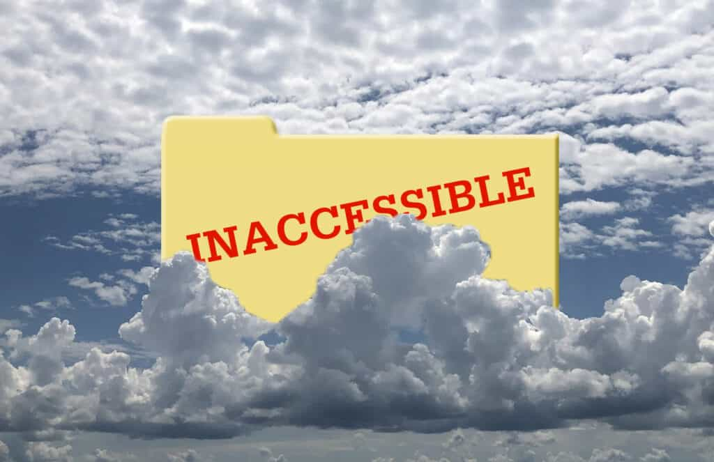 Picture of a yellow file folder partially obscured by towering clouds. The word INACCESSIBLE is imprinted on the file folder.