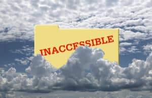 Picture of a yellow file folder partially obscured by towering clouds. The word INACCESSIBLE is imprinted in red on the file folder.